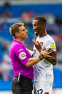 Today's referee Joshua Smith tries to calm Bournemouth forward Jaidon Anthony  (32) during the EFL Sky Bet Championship match between Cardiff City and Bournemouth at the Cardiff City Stadium, Cardiff, Wales on 18 September 2021.