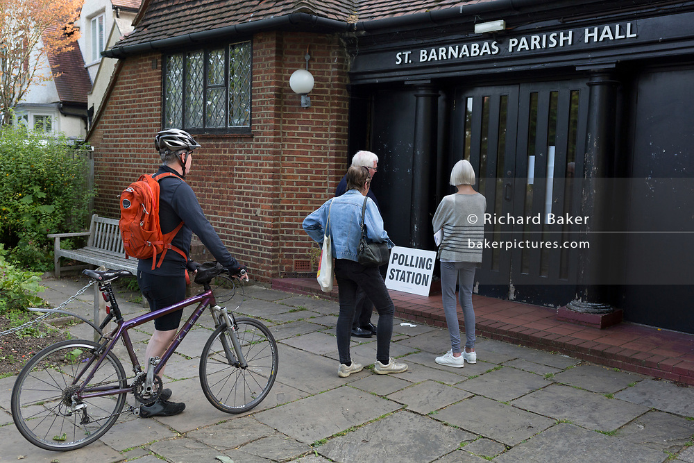 Before voting for the European Elections commences at 7am, local voters wait for doors to open outside the Polling Station at St. Barnabas Parish Hall in Dulwich Village, on 23rd May 2019, in south London, England UK.
