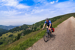 Mature man riding bike on hilly areas