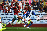 Demarai Gray of Birmingham City  (r) gets his cross in under pressure. Skybet football league championship match, Burnley  v Birmingham City at Turf Moor in Burnley, Lancs on Saturday 15th August 2015.<br /> pic by Chris Stading, Andrew Orchard sports photography.