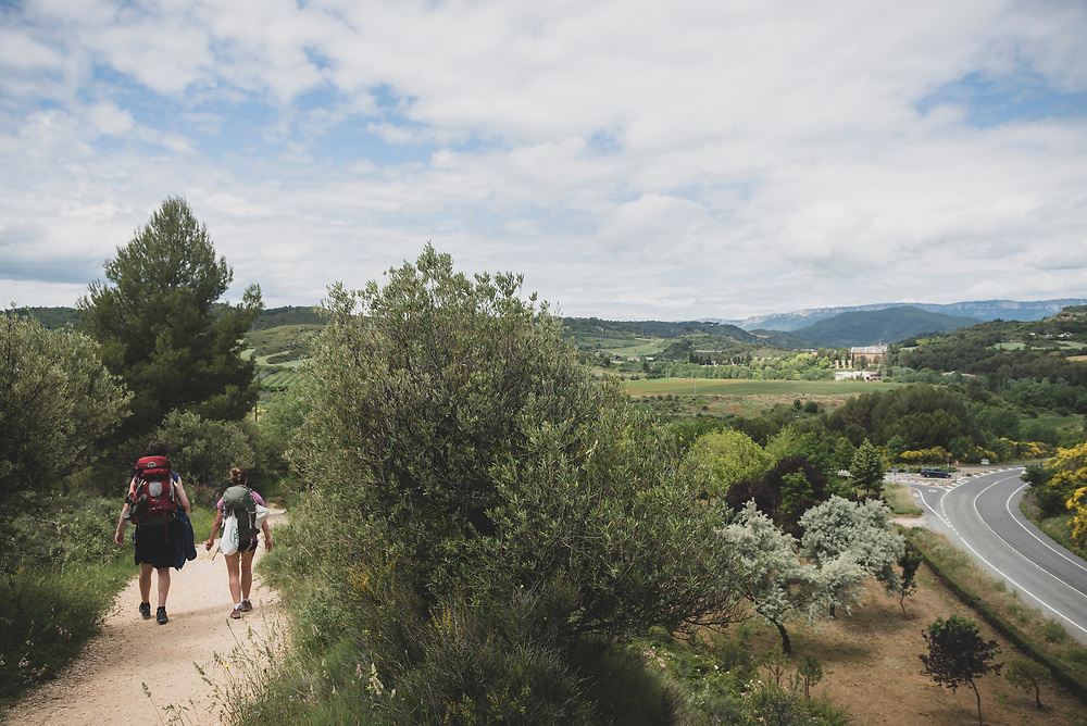 Alex from the USA and Marie from Germany approach the town of Estella as they complete the day's walk on the Camino de Santiago in the Navarre region of Spain.<br /><br />(June 4, 2018)