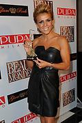 Beau Monde Awards 2012 in het Amstel Hotel, Amsterdam.<br /> <br /> Op de foto:  Leontien van Moorsel met de Make-over Award