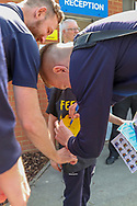 AFC Wimbledon striker Joe Pigott (39) signing Feed The Pig T shirt during the EFL Sky Bet League 1 match between AFC Wimbledon and Bristol Rovers at the Cherry Red Records Stadium, Kingston, England on 19 April 2019.
