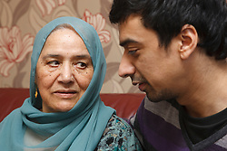South Asian son with his mother.