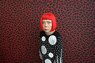 Japanese artist Yoyoi Kusama stands in front of one of her paintings in her studio, prior to attending the 2006 Praemium Imperiale art awards, in the Meiji-Jingu Kinenkan hall, Tokyo, Japan, on Wednesday, Oct. 18,  2006. The five laureates in 2006 were internationally renowned  Japanese artist Kusama Yayoi, French sculptor Christian Boltanski, German architect Frei Otto, American musician Steve Reich, and Russian dancer ballerina Maya Plisetskaya. All receive an honorarium of 15 million Yen, and a medal. The Japan Art Association, giver of the awards, is the oldest cultural foundation in Japan, established in 1887. The laureates are chosen each year by an international jury, from a list of nominees put forward by advisors. The awards are held annually in Tokyo in the presence of Prince and Princess Hitachi.