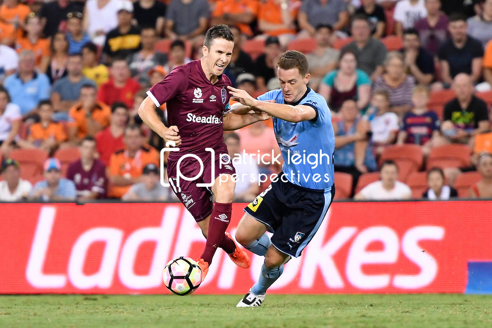BRISBANE, AUSTRALIA - FEBRUARY 3: Matt McKay of the Roar controls the ball under pressure from Brandon O'Neill of Sydney during the round 18 Hyundai A-League match between the Brisbane Roar and Sydney FC at Suncorp Stadium on February 3, 2017 in Brisbane, Australia. (Photo by Patrick Kearney/Brisbane Roar)