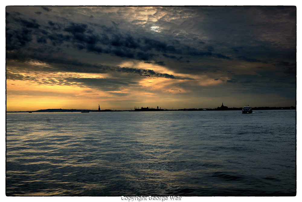 'Silver Lining'<br /> Dramatic clouds hang above stoic Lady Liberty — she looks ahead optimistically.