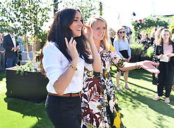 The Duchess of Sussex (left) with Kate Stephens, CCEO of Smart Works at the launch the Smart Works capsule collection at John Lewis in Oxford Street, London.
