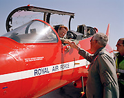 Wing Commander ill Ramsey congratulates pilots of the 'Red Arrows', Britain's Royal Air Force aerobatic team on PDA Day at RAF Akrotiri, Cyprus. PDA (or 'Public Display Authority'), is when they are allowed by senior RAF officers to perform as a military aerobatic show in front of the public - following a special test flight when their every move and mistake is assessed and graded. Until that day arrives, their training and practicing is done in the privacy of their own airfield at RAF Scampton in Lincolnshire, UK or here in the glare of Akrotiri. The pilots are called reds and their ground crew, the Blues after their summer air show uniforms.