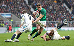England's Elliot Daly (left) and Chris Robshaw (right) tackle Ireland's Jordan Larmour (centre) during the NatWest 6 Nations match at Twickenham Stadium, London.
