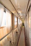 Corridor view on-board the BAM (Baikal-Amur Mainline) Railway Line. Siberia, Russia