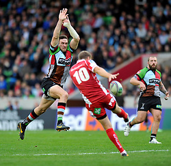 Harlequins replacement Tom Guest looks to charge a kick by Scarlets fly half Rhys Priestland down - Photo mandatory by-line: Patrick Khachfe/JMP - Tel: Mobile: 07966 386802 12/10/2013 - SPORT - RUGBY UNION - Twickenham Stoop - London - Harlequins V Scarlets - Heineken Cup