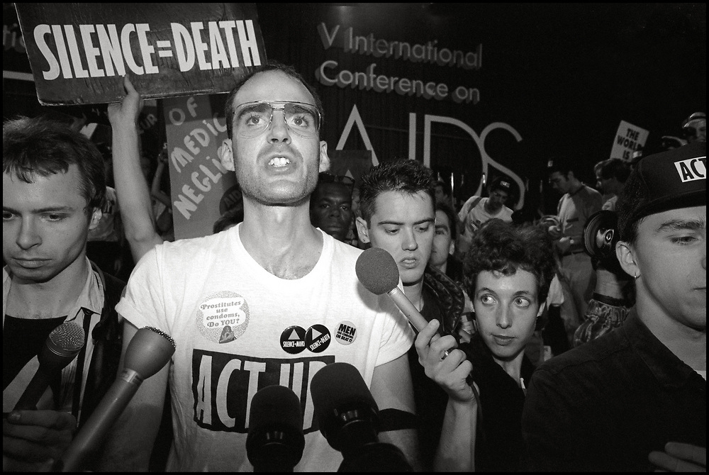 Conyers Thompson of ACT UP New York takes the stage at the opening ceremonies of the Fifth International AIDS Conference in Montreal on June 4, 1989.<br /> <br /> ACT UP NY stormed the Fifth International AIDS Conference in Montreal, at the time a members-only event for doctors and HIV/AIDS researchers. They took over seats reserved for dignitaries, and released their first Treatment and Data report calling for speedier access to AIDS drugs.