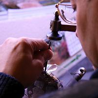 Europe, Spain, Toledo. A swordsmith artisan at work in Toledo, Spain.
