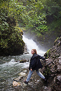 Liana Welty hikes to the base of Thunderbird Falls in Chugach State Park near Anchorage, Alaska.