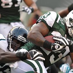 Nov 15, 2009; East Rutherford, NJ, USA; Jacksonville Jaguars linebacker Justin Durant (56) tackles New York Jets running back Shonn Greene (23) during second half NFL action in the Jacksonville Jaguars 24-22 victory over the New York Jets at Giants Stadium.