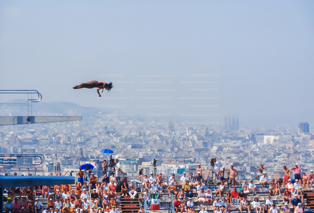 BARCELONA - JULY 27:  Maria Alcala of Mexico competes in the Women's 10 meter Diving final at the Piscina Municipal de Montjuic on July 27, 1992 during the Summer Olympics in Barcelona, Spain.  Visible in the background are the towers of the Basilica de la Sagrada Familia designed by architect Antoni Gaudi.  (Photo by David Madison/Getty Images)