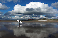 a surfer on the beach at Rest Bay, Porthcawl, South Wales. pic by Andrew Orchard