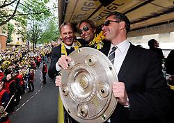 15.05.2011, City, Dortmund, GER, 1.FBL, Borussia Dortmund Autocorso Deutscher Meiser 2011, im Bild Geschäftsführer WATZKE, Trainer KLOPP und Manager Michael ZORC mit Meisterschale  //   German 1.Liga Football ,  Borussia Dortmund , Dortmund, 15/05/2011 . EXPA Pictures © 2011, PhotoCredit: EXPA/ nph/  Conny Kurth       ****** out of GER / SWE / CRO  / BEL ******