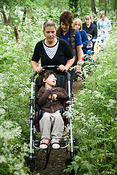Physically disabled children out on nature walk,