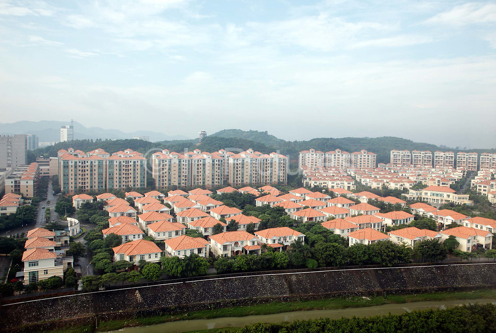 A view of a new posh residential development in Qingxi Township, Dongguan, Guangdong Province, China, on July 28, 2010. Like many towns in the Pearl River Delta region, Qingxi was a sleepy town surrounded by farms before economic reforms but is now the home to hundreds of factories.