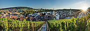 At sunset seen from the Munot fortress, admire a panorama of vineyards and Schaffhausen's Old Town, a patchwork of rooftops and spires, in Switzerland, Europe. Left to right are the church steeples of Münster (first built 1064) and St Johann. This image was stitched from multiple overlapping photos.