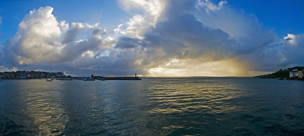 St Ives as the harbour empties in the sunrise, Cornwall.<br /> <br /> St Ives (Cornish: Porth Ia, meaning St Ia's cove) is a seaside town, civil parish and port in Cornwall, England, United Kingdom. The town lies north of Penzance and west of Camborne on the coast of the Celtic Sea. In former times it was commercially dependent on fishing. The decline in fishing, however, caused a shift in commercial emphasis, and the town is now primarily a popular holiday resort, notably achieving the title of Best UK Seaside Town from the British Travel Awards in both 2010 and 2011. St Ives was incorporated by Royal Charter in 1639. St Ives has become renowned for its number of artists. It was named best seaside town of 2007 by the Guardian newspaper. It should not be confused with St Ive, a village and civil parish in south-east Cornwall.