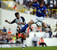 Photo: Chris Ratcliffe.<br />Tottenham Hotspur v Everton. The Barclays Premiership.<br />15/10/2005.<br />Lee Young-Pyo clears the ball from James Beattie of Everton