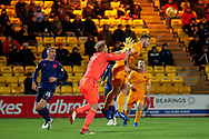 Zdenek Zlamal (#1) of Heart of Midlothian fouls Craig Halkett (#26) of Livingston FC in the box to give away a penalty during the Ladbrokes Scottish Premiership match between Livingston FC and Heart of Midlothian FC at the Tony Macaroni Arena, Livingston, Scotland on 14 December 2018.