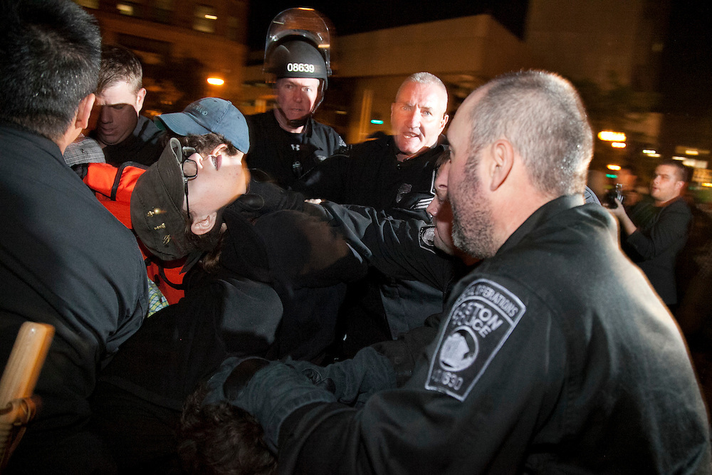 A protester is choked by the Bpston Police during the first eviction in Boston, Massachusetts, October 11, 2011.