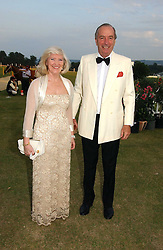 MISS LIBBY REEVES PURDY and MR JOHN CHALK at the Cowdray Gold Cup Golden Jubilee Ball held at Cowdray Park Polo Club, on 21st July 2006.<br /><br />NON EXCLUSIVE - WORLD RIGHTS