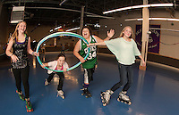 Elizabeth Sweeney, Gabrielle Isabelle, Quincy Morris and April Rivers have no plans on slowing down during the 24 hour Skate a Thon at Skate Escape to benefit the WLNH Children's Auction Friday evening.  (Karen Bobotas/for the Laconia Daily Sun)