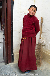 Young Tibetan monks in Marpha Monastery while we visited on Motorcycle Sherpa's Ride to the Heavens motorcycle adventure in the Himalayas of Nepal. On the fourth day of riding, we went from Kalopani to Muktinath. Thursday, November 7, 2019. Photography ©2019 Michael Lichter.