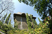 """One of Vienna's Flak (Anti-Aircraft-Gun) Towers 6 of which have been built by the Nazis in World War 2 against Allied bombing raids. Here the """"Zielturm"""" (aiming tower) at Arenbergpark."""