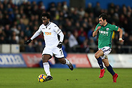 Wilfried Bony of Swansea city breaks away from Claudio Yacob of West Bromwich Albion (r).Premier league match, Swansea city v West Bromwich Albion at the Liberty Stadium in Swansea, South Wales on Saturday 9th December 2017.<br /> pic by  Andrew Orchard, Andrew Orchard sports photography.