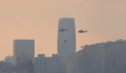 October 1, 2018 - Hong Kong, CHINA - PLA Airforce helicopters hanging China national flag and official banner of HKSAR perform fly-by over Victoria Harbour from West to Eastward exactly at 8:00 am in the morning as part of 69th anniversary of China national day celebration. Oct-1,2018 Hong Kong.ZUMA/Liau Chung-ren (Credit Image: © Liau Chung-ren/ZUMA Wire)