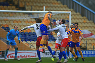 Andy Cook of Mansfield Town (11) heads the ball during the The FA Cup match between Mansfield Town and Dagenham and Redbridge at the One Call Stadium, Mansfield, England on 29 November 2020.