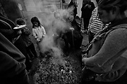 """Preparing the fire for cooking and warm themselves from the cold.<br /> The gipsies call it """"the Cult"""", it is a kind of pact that they get together twice a week in a common hut to pray for good and exorcise the evil. Inside the hut there´s a heavy atmosphere and things seem to be a blend of fantasy and reality. Tens of gipsies form a circle of screams and cries and you can hear a mix of prays, complains, desperation and guilt. A gipsie women faints on the floor almost like she has been exorcised and she had a demon inside her, slowly with the help of the others she recovers.<br /> The truth is that the cult is a way that gipsies chose to express themselves, something that is very much theirs, just like the sound of the gipsies guitars, shows something very real, the suffering of their spirits."""