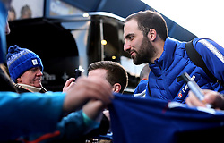 Chelsea's Gonzalo Higuain greets fans as he arrives at Stamford Bridge before the match
