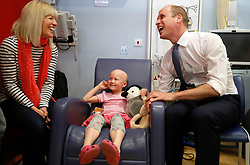 The Duke of Cambridge meets patient Daisy Wood, 6, and her mother Katie during a visit to the Royal Marsden NHS Foundation Trust in Sutton, Surrey, marking 10 years since he became president of the centre.