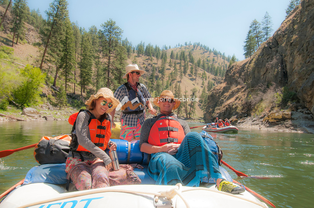 Smiles from the oar boat, The Impassible Canyon on the Middle Fork of the Salmon River during six day rafting vacation, Idaho.