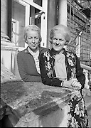 First Sisters Elected To The Oireachtas.    (N98)..1981..21.10.1981..10.21.1981..21st October 1981..Deputy Carrie Acheson and Senator Tras Honan were the first sisters ever to be elected to the Oireachtas at the same time. Senator Honan was elected to the Administrative Panel of the Seanad in 1977 and was re-elected this year. Deputy Acheson, Alderman of Clonmel Corporation, was elected to the Dáil for the first time last June, she is a company director and a member of the Irish Management Institute. Both sisters are members of Fianna Fáil...Image shows Senator Tras Honan (left) and Deputy Carrie Acheson posing for pictures at Leinster House, Dublin.