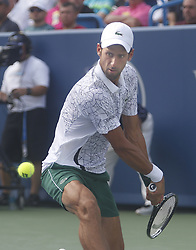 August 19, 2018 - Mason, Ohio - Novak Djokovic hits the ball as he takes on Roger Federer in the finals of the Western and Southern Open at the Lindner Family Tennis Center in Mason, Ohio on Sunday, August 19, 2018.  Djokovic won the match 6-4, 6-4.  The Cincinnati Masters is an annual outdoor hardcourt tennis event held in Mason near Cincinnati, Ohio. The event started on September 18, 1899 and is the oldest tennis tournament in the United States played in its original city. (Credit Image: © Leigh Taylor via ZUMA Wire)