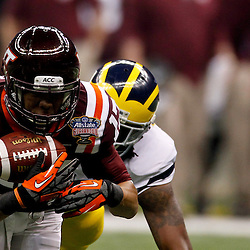 January 3, 2012; New Orleans, LA, USA; Virginia Tech Hokies cornerback Kyle Fuller (17) intercepts a pass against the Michigan Wolverines during the first quarter of the Sugar Bowl at the Mercedes-Benz Superdome.  Mandatory Credit: Derick E. Hingle-US PRESSWIRE