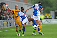 Ellis Harrison of Bristol Rovers (c) beats Newport Captain David Pipe to the ball. Skybet League two match, Newport county v Bristol Rovers at Rodney Parade in Newport, South Wales on Saturday 17th August 2013.pic by Phil Rees ,Andrew Orchard sports photography,