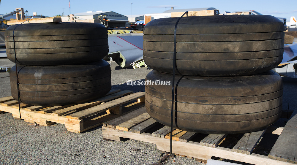 The wheels of the Boeing 757 are stacked on crates and saved for resale at the Moses Lake Airport. <br /> <br /> Mike Siegel/The Seattle Times