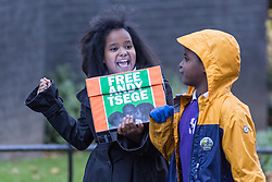 """© Licensed to London News Pictures. 29/11/2016. London, UK. Yilak Andargachew and Menabe Andargachew bring a petition to Downing Street calling on the Prime Minister to seek the release of British man Andargachew """"Andy"""" Tsege, who is in his sixties, who is in prison in Ethiopia under the shadow of a death sentence. Andargachew Tsegehas been detained in the country since he was removed from an airport in Yemen in June 2014. The father-of-three, who fled the country in the 1970s and sought asylum in the UK in 1979, had been a prominent critic of Ethiopia's ruling party. Photo credit : Tom Nicholson/LNP"""