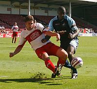 Photo: Steve Bond.<br />Walsall v Swansea City. Coca Cola League 1. 25/08/2007. Angel rangel Is tackled