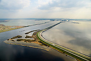 Nederland, Zeeland, Gemeente Tholen, 01-04-2016; Oesterdam met rechts de Oosterschelde. Diagonaal in het midden het kanaal van de Schelde-Rijnverbinding richting Kreekraksluizen, begrensd door de Markiezaatskade en Markiezaatsmeer.<br /> De dam is een compartimenteringsdam en scheidt het zoute water van de Oosterschelde van het zoete water van het  Zoommeer<br /> Oesterdam, division between salt and sweet water, part of the Delta Works.<br /> <br /> luchtfoto (toeslag op standard tarieven);<br /> aerial photo (additional fee required);<br /> copyright foto/photo Siebe Swart