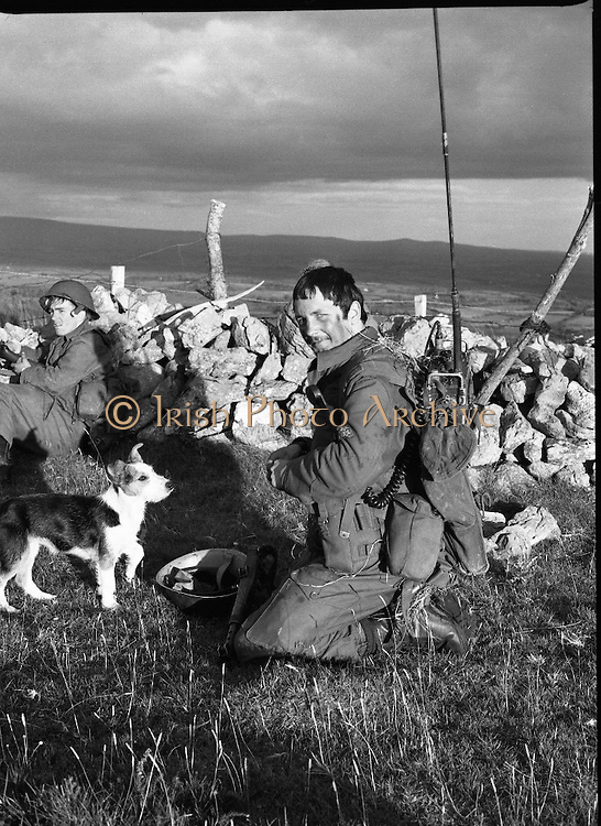 """Army Exercises In Co Sligo.   (L37).<br /> 1977.<br /> 05.09.1977.<br /> 09.05.1977.<br /> 5th September 1977.<br /> The Army Reserve Brigade, which is made up of regular units from the Southern Command, are conducting a series of conventional military exercises in counties Mayo and Sligo from the 5th to the 9th September. Approximately 1,500 men and 250 vehicles are involved. The exercise was codenamed """"Humbert"""" after an ill fated expedition by French troops into Ireland on 23rd August 1798. 1,100 French troops with Irish support took on the incumbent English forces. After some initial success they were defeated at Ballinamuk on 8th Sept 1798 by the army of Cornwallis.<br /> <br /> A 'victim of the war' is pictured being fed by the signalman."""